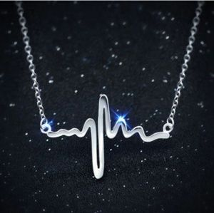 RESERVED silver heartbeat necklace